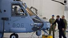 Defence Minister Peter MacKay inspects a new Canadian military Sikorsky CH-148 Cyclone helicopter at 12 Wing Shearwater in Halifax on Thursday May 26, 2011. (Andrew Vaughan/The Canadian Press)