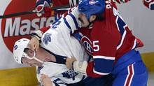 Montreal Canadiens right wing George Parros, right, fights with Toronto Maple Leafs right wing Colton Orr during second period National Hockey League action Tuesday, October 1, 2013 in Montreal (The Canadian Press)