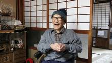 Jiroemon Kimura poses for a photograph in Kyotango City, Kyoto Prefecture, Japan, in this handout photograph provided to the media on Thursday, Dec. 13, 2012. Kimura, a 115-year-old Japanese man born when Queen Victoria still reigned over the British Empire, became the oldest man in recorded history today, according to record keepers. (Kyotango City Hall/Bloomberg)
