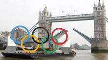 Olympic rings mounted on a barge are manoeuvred to pass under Tower Bridge during a promotional event on the River Thames in London February 28, 2012. (ANDREW WINNING/Reuters)