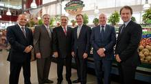 Left to right, Marché Adonis founders Elie Cheaib, Georges Ghrayed and Jamil Cheaib are pictured with Metro CEO Eric La Fleche, COO Robert Sawyer and CFO Richard Dufresne after announcing that Metro has bought a majority stake in the Montreal grocery chain. (Peter McCabe/The Canadian Press/Peter McCabe/The Canadian Press)