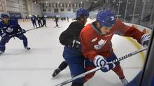 David Clarkson (71) is checked along the boards by Zachary Yuen during training camp. (FRED LUM/THE GLOBE AND MAIL)