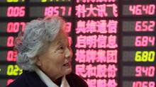An investor looks at the stock price monitor at a private securities company Monday Dec. 9, 2013 in Shanghai, China. (AP)