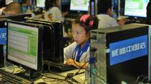 Chinese children attend a computer class to learn how to properly use the Internet, in Beijing on June 7, 2010. (STR/AFP/Getty Images)