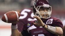 McMaster University Marauders' Kyle Quinlan prepares to throw the ball during the second half of play against the Laval University Rouge et Or's at the Vanier Cup Canadian university football championship in Vancouver, B.C., on Friday November 25, 2011. The Montreal Alouettes are giving Canadian quarterback Kyle Quinlan a shot to crack their roster.The CFL club announced Tuesday it had signed McMaster quarterback to a two-year contract. (JONATHAN HAYWARD/THE CANADIAN PRESS)