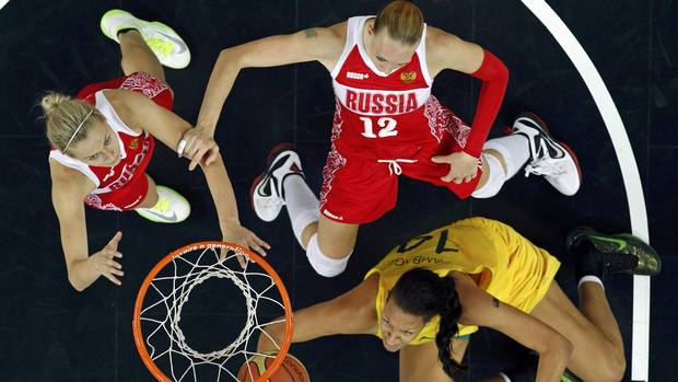 Australia's Liz Cambage (R) puts up a shot as Russia's Irina Osipova (C) and Nadezhda Grishaeva during their women's bronze medal basketball match at the North Greenwich Arena during the London 2012 Olympic Games August 11, 2012. (MIKE SEGAR/REUTERS)