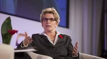 Kathleen Wynne muses about a possible cut to business tax credits at the Ontario Economic Summit. (Philip Cheung For The Globe and Mail)