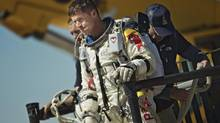 This photo provided by Red Bull Stratos shows pilot Felix Baumgartner of Austria reacting after his mission was aborted in Roswell, N.M., Tuesday, Oct. 9, 2012. (Red Bull Stratos/Joerg Mitter/AP)