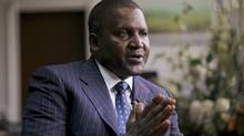 Aliko Dangote, founder and CEO of Dangote Group, gestures during an interview in his office in Lagos in this file photo. Mr. Dangote's entrepreneurial skills have helped make him Africa's richest person. (AKINTUNDE AKINLEYE/REUTERS)