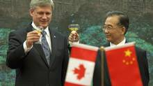 Prime Minister Stephen Harper makes a toast with Chinese Premier Wen Jiabao after a signing ceremony at the Great Hall of the People in Beijing on Thursday, December 3, 2009.
