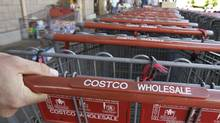 Costco shopping carts are shown at the entrance of Costco in Mountain View, Calif. in this file photo. (Paul Sakuma/AP)
