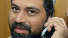 Pakistani journalist Syed Saleem Shahzad, talks on his cell phone at a local hotel after his release in Quetta, 28 November 2006. (BANARAS KHAN/AFP/Getty Images/BANARAS KHAN/AFP/Getty Images)