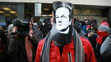 A supporter of Julian Assange wears a mask depicting his face outside Westminster Magistrates Court on December 7, 2010 in London, England. (Peter Macdiarmid/Peter Macdiarmid/Getty Images)