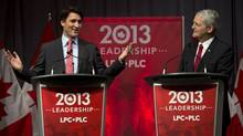 Justin Trudeau, left, and Marc Garneau exchange views at the Liberal party leadership debate in Halifax on Sunday, March 3, 2013. (Andrew Vaughan/THE CANADIAN PRESS)