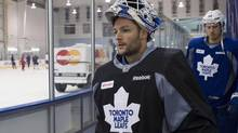 Toronto Maple Leafs goaltender Jonathan Bernier makes his way onto the ice for a practice session at their NHL training camp in Toronto on Thursday September 12, 2013. (Chris Young/THE CANADIAN PRESS)