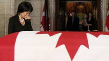 Olivia Chow stands before the coffin containing her husband and Canada's leader of the Opposition Jack Layton in the Center Block of Parliament Hill in Ottawa August 24, 2011. Layton will be lying-in-state before his state funeral on August 27. (PATRICK DOYLE/Patrick Doyle/Reuters)