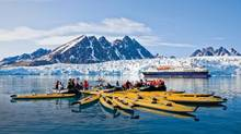 Guests from the Lindblad Expedition ship National Geographic Explorer kayaking near Monaco Glacier on Spitsbergen Island in the Svalbard Archipelago in the summer months. (Michael S. Nolan/wildlifeimages.net)