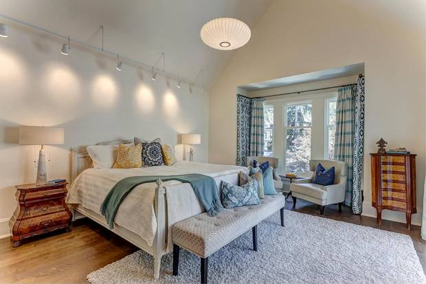The master bedroom, which has cathedral ceilings, occupies the back half the second floor.