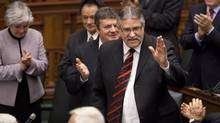 Newly elected Speaker of the Ontario Legislature Liberal MPP Dave Levac is congratulated by fellow MPP's at Queen's Park Nov. 21 2011. (Moe Doiron/Moe Doiron/The Globe and Mail)