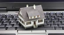 Technology companies already have software that's specially designed to enable people to do the 'paperwork' to buy houses online. (Amy Walters/iStockphoto)
