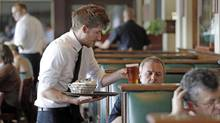 University of Guelph researchers say a no-tipping policy in restaurants would be 'great for equity in the food-service business.' (The Associated Press)