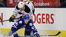 Toronto Maple Leafs' Nikolai Kulemin (41) battles for the puck during an NHL game in Toronto January 21, 2013. Kulemin may be asked to fill one of the holes created in Toronto's line-up due to injuries and suspensions. (MARK BLINCH/REUTERS)