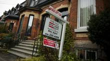 "A ""For Sale"" sign is posted outside of at Toronto townhome Tuesday Oct. 25, 2011. ( (Tim Fraser/Tim Fraser for The Globe and Mail)"