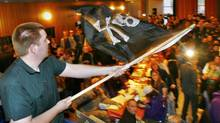 A supporter of Sweden's Pirate Party waves the Jolly Roger flag at an election night party as results are announced in EU Parliamentary elections in Stockholm June 7, 2009. A Pirate Party candidate is running in the federal byelection for Winnipeg North. (BOB STRONG/Bob Strong/Reuters)