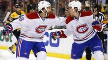 Montreal Canadiens right wing Dale Weise celebrates his goal with teammate right wing Brandon Prust (USA TODAY Sports)
