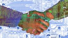 Handshake and circuit board (© 2003 Thinkstock LLC)