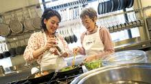 Kiyomi Ruvalcaba, 31, and her mother Julie Nishino, 65, in the kitchen at the Calphalon Culinary Centre (Kevin Van Paassen/The Globe and Mail/Kevin Van Paassen/The Globe and Mail)