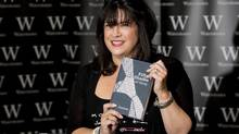E L James, author of Fifty Shades of Grey, poses for photographers during a book signing in London September 6, 2012. (Neil Hall / Reuters/Reuters)