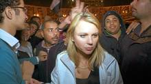 "In this Feb. 11, 2001 photo released by CBS, ""60 Minutes"" correspondent Lara Logan is shown covering the reaction in in Cairo's Tahrir Square the day Egyptian President Hosni Mubarak stepped down. CBS News says Logan was attacked Friday, and suffered a brutal beating and sexual assault before being saved by a group of women and an estimated 20 Egyptian soldiers. She is recovering in a U.S. hospital. Logan, CBS News' chief foreign affairs correspondent, is one of at least 140 correspondents who have been injured or killed since Jan. 30 while covering the unrest in Egypt, according to the Committee to Protect Journalists. (AP Photo/CBS News/AP Photo/CBS News)"