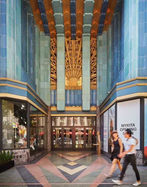 The 1930 Eastern Columbia building, designed by architect Claud Beelman, reflects recent changes in downtown Los Angeles.