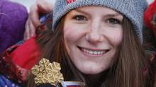 First placed Kaya Turski of Canada shows off her gold medal after the women's Slopestyle race at the Freestyle World Ski Championships in Voss March 9, 2013. (NTB SCANPIX/REUTERS)