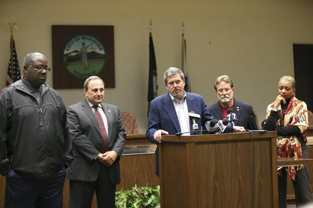Roanoke Vice-Mayor David B. Trinkle, middle, is joined by fellow city councillors at a news conference where they denounced comments that Mayor David Bowers made about Syrian refugees.