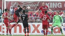 D.C. United's Perry Kitchen, centre left, heads home the winning goal past Toronto FC 's goalkeeper Joseph Bendik, right, during second half MLS action in Toronto on Saturday, July 5, 2014. (Chris Young/The Canadian Press)