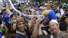 Winnipeg Blue Bomber fans party outside Mosaic Stadium before the Canadian Football League game against the Saskatchewan Roughriders in Regina September 5, 2010. (REuters)