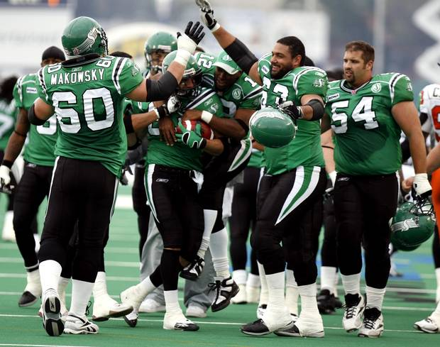 Saskatchewan Roughriders (# 83) Andy Fontuz holds the game winning ball he caught for a touchdown in overtime to beat the B.C. Lions as the rest of the team celebrates on Sunday Sept.24, 2006 at Taylor Field in Regina.