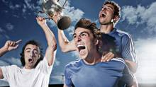 Soccer players cheering with trophy (Paul Bradbury/Getty Images/OJO Images)