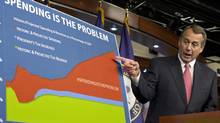 "House Speaker John Boehner points to a chart to emphasize his talking point that government spending complicates the negotiations on avoiding the so-called ""fiscal cliff,"" during a news conference on Capitol Hill in Washington, Dec. 13, 2012. (J. Scott Applewhite/AP)"