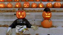 Carved pumpkins are displayed as part of Pumpkin Mania on the Transylvania University campus in Lexington, Ky. (Charles Bertram/AP)