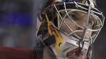 Phoenix Coyotes goalie Mike Smith pauses during a break in play against the Los Angeles Kings during the third period of Game 4 of their NHL Western Conference final playoff hockey game in Los Angeles, California, May 20, 2012. REUTERS/Lucy Nicholson (Lucy Nicholson/Reuters)