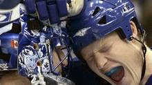 Toronto Maple Leafs defenceman Wade Belak, right, celebrates their 4-2 victory over the New York Islanders with goalie Andrew Raycroft at the end of their NHL hockey game in Toronto November 20, 2006. (J.P. MOCZULSKI/REUTERS/J.P. MOCZULSKI/REUTERS)