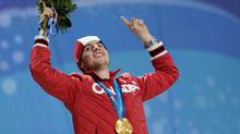 Gold medalist Alexandre Bilodeau celebrates during the medal ceremony for the men's moguls freestyle skiing at BC Place during the Vancouver Winter Olympics. (Martin Bureau/AFP/Getty Images)