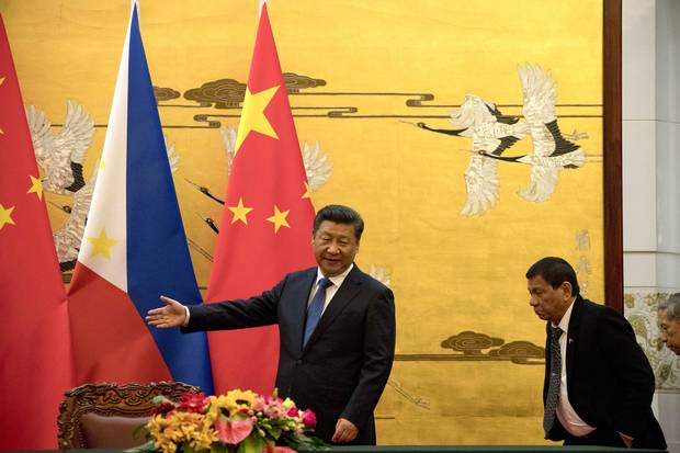 Philippine President Rodrigo Duterte, right, is shown the way by Chinese President Xi Jinping before a signing ceremony in Beijing on Oct. 20, 2016. Read Nathan VanderKlippe's full report on Mr. Duterte's visit to China and what he said there.
