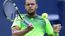 Jo-Wilfried Tsonga, of France, hit s forehand to Andy Murray, of Great Britian, during action at the Rogers Cup tennis tournament Friday August 8, 2014 in Toronto. (Frank Gunn/THE CANADIAN PRESS)