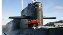 The crew of Russia's nuclear-powered submarine Yekaterinburg line up on its deck as it returns to Gadjiyevo base in Murmansk region, in this file photo taken September 26, 2006. (Reuters/REUTERS)