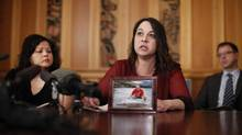 Ronda Roche talks to the media about her late husband Glenn, as she joins injured workers from Burns Lake,B.C. and family members of workers killed in the Babine Mill explosion and Lakeland Mill at B.C. Legislature during a press conference held in Victoria, B.C. Wednesday March 6, 2014. (Chad Hipolito/Globe and Mail)