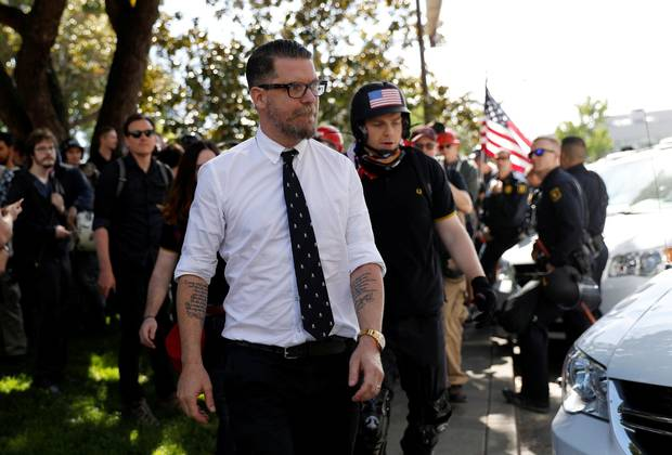 Gavin McInnes leaves a group of protesters after giving a speech at the University of California, Berkeley, April 27, 2017.